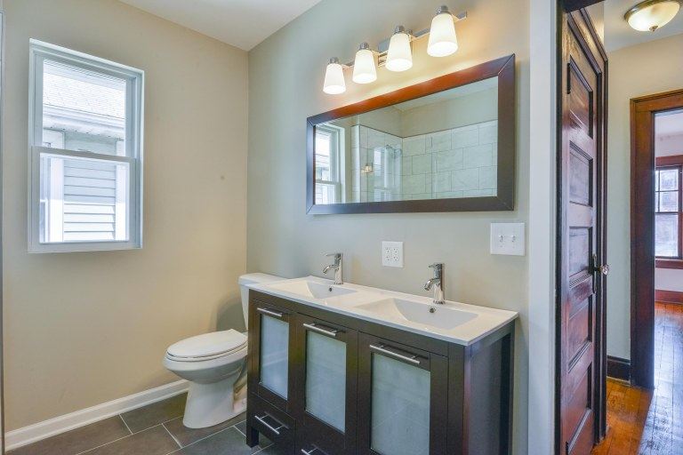 286 E Woodrow Avenue - Custom vanity, mirror, fixtures, & ceramic tile flooring