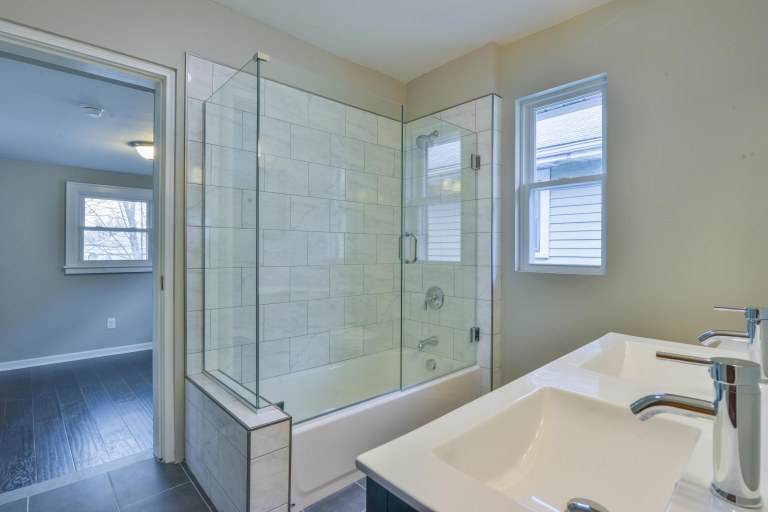 286 E Woodrow Avenue - Ceramic tile flooring & tile bath surround with frameless glass shower door